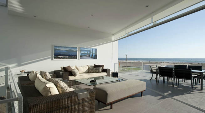 Decoarq arquitectura decorativa for Casa moderna frente al mar