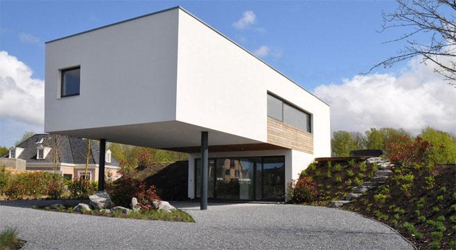Sencilla vivienda minimalista en la haya for Casa minimalista arquitectura