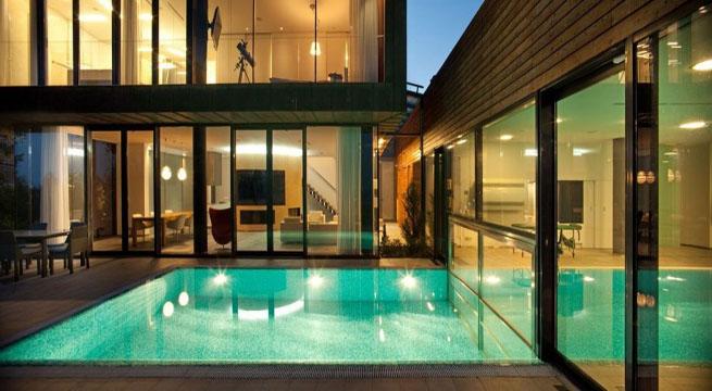 Decoarq arquitectura decorativa for Una casa con piscina